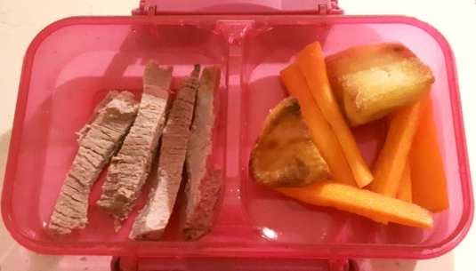 Roast beef, roast potatoes and carrots